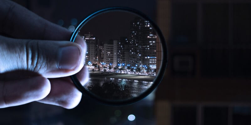 Looking through an eyeglass at a city